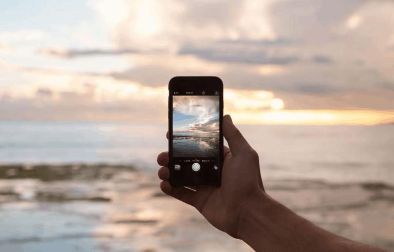 Phone on beach, mindful technology